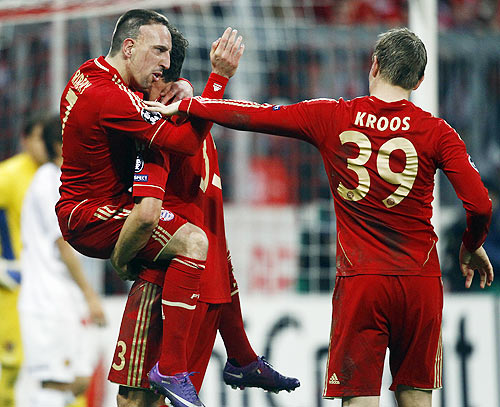 Bayern Munich's Franck Ribery, Mario Gomez and Toni Kroos celebrate their fifth goal against FC Basel during their Champions League round-of-16 second leg match in Munich