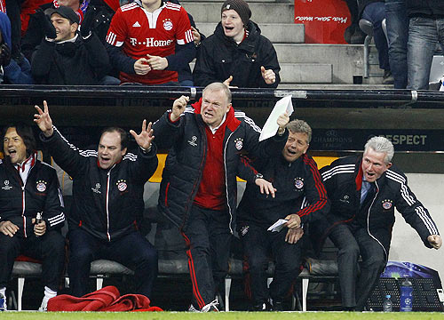 Munich's manager Nerlinger and coach Heynckes celebrate