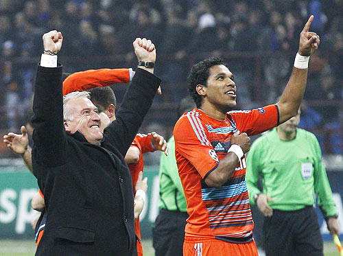 Olympique Marseille's coach Deschamps celebrates next to Brandao at end of their Champions League soccer match against Inter Milan at Giuseppe Meazza stadium
