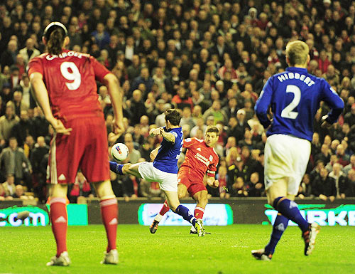 Steven Gerrard of Liverpool scores the opening goal