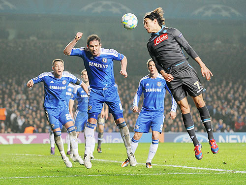 Frank Lampard of Chelsea and Edinson Cavani of Napoli jump for the ball during the UEFA Champions League