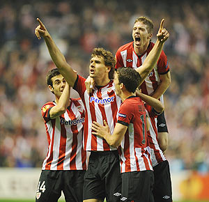 Fernando Llorente of Bilbao celebrates with teammates after scoring against Manchester United during their UEFA Europa League Round of 16 second leg match on Thursday