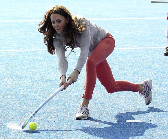 Catherine, Duchess of Cambridge, plays hockey with the Great Britain hockey teams at the Riverside Arena in the Olympic Park in London