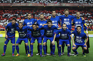 Barcelona's players pose with T-shirts in support of teammate Eric Abidal before the start of their La Liga match against Sevilla at Ramon Sanchez Pizjuan stadium in Seville on Saturday