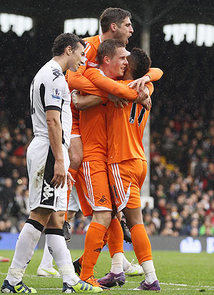 Swansea's Gylfi Sigurdsson (2nd from right) is congratulated by team-mates after scoring against Fulham on Saturday