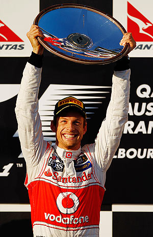 McLaren's Jenson Button celebrates on the podium after winning the Australian Formula One Grand Prix on Sunday