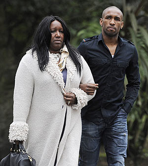 Tottenham Hotspurs' footballer Jermain Defoe (right) arrives with his mother Sandra St Helen at the London Chest Hospital in London to visit Fabrice Muamba on Sunday