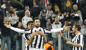 Juventus' Mirko Vucinic (centre) celebrates with teammates after scoring against AC Milan during their Italian Cup semi-final in Turin on Tuesday