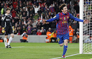 Barcelona's Lionel Messi celebrates after scoring against Granada on Tuesday