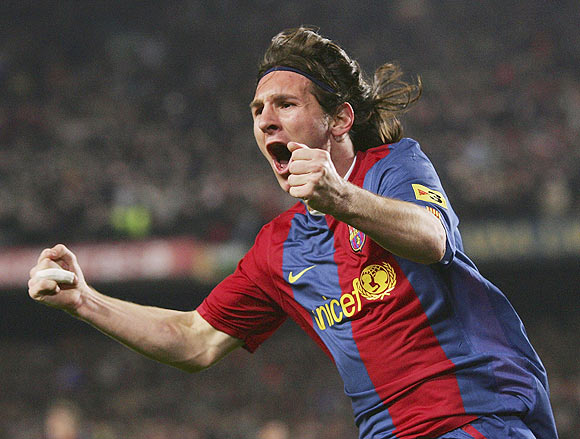 Lionel Messi celebrates after scoring against Real Madrid in 2007