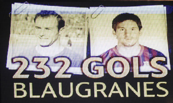 The video scoreboard displays the number of goals scored by Lionel Messi (right) and FC Barcelona player Cesar following Messi's record-equalling goal against Granada on Tuesday