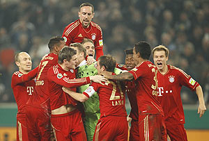 Manuel Neuer, goalkeeper of Bayern Munich celebrates with his team mates after saving the decisive penalty of their German Cup semi-final against Borussia Moenchengladbach in Moenchengladbach on Wednesday
