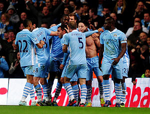 Manchester City's Samir Nasri (shirtless) is congratulated by teammates after scoring his team's second goal during their EPL match against Chelsea on Wednesday