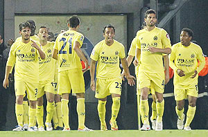 Villarreal's players celebrate after scoring against Real Madrid during their La Liga match on Wednesday