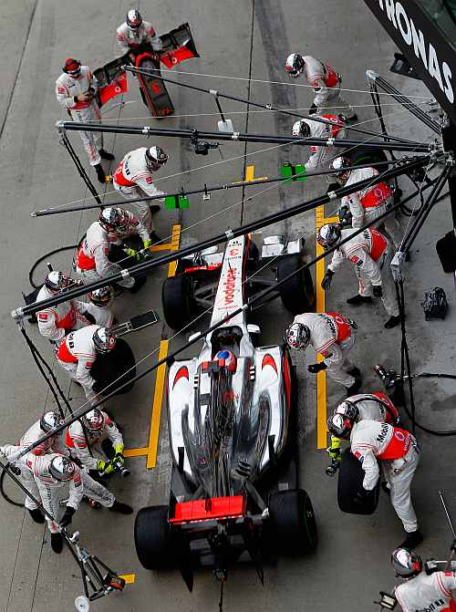 McLaren's Jenson Button stops for a pitstop during the Malaysian Formula One Grand Prix at the Sepang Circuit