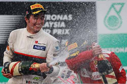 Sergio Perez celebrates on the podium after finishing second during the Malaysian Formula One Grand Prix at the Sepang Circuit