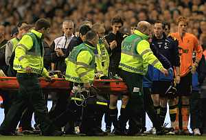 Fabrice Muamba of Bolton Wanderers is taken off on a stretcher, after receiving CPR treatment on the pitch after suddenly collapsing during the FA Cup Sixth Round match vs Tottenham Hotspur