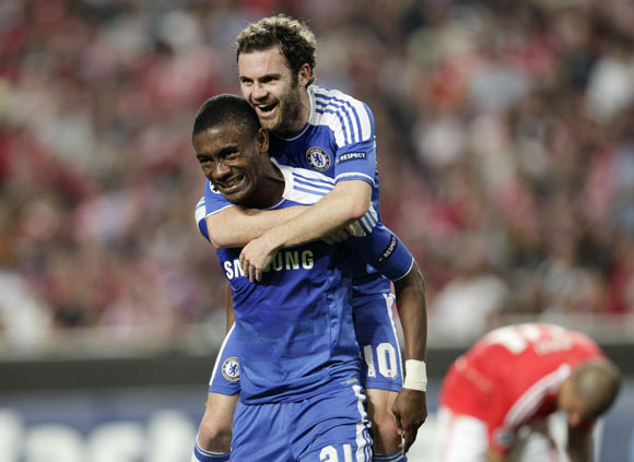 Chelsea's Juan Mata (top) congratulates team-mate Salomon Kalou after scoring a goal against Benfica during their Champions League quarter-final first leg soccer match at the Luz stadium in Lisbon