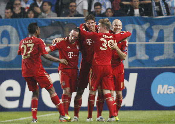 Bayern Munich's Mario Gomez (C) celebrates with team mate after scoring a goal against Olympique Marseille during their quarter-final first leg at the Velodrome Stadium in Marseille
