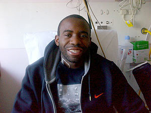 Bolton Wanderers footballer Fabrice Muamba poses for a photograph in the London Chest Hospital in east London March 30, 2012. The photograph, was released by members of Muamba's family on Twitter on Friday