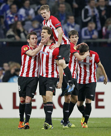 Athletic Bilbao's Fernando Llorente (C) celebrates his goal against Schalke 04 during their Europa League first leg quarter-final soccer match in Gelsenkirchen