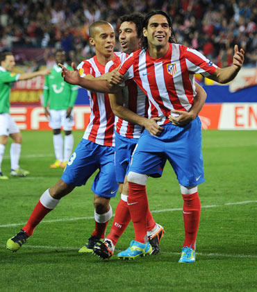 Falcao of Club Atletico de Madrid celebrates scoring his sides early opening goal during the UEFA Europa League quarter-final first leg match