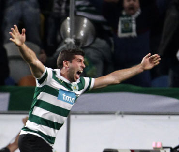 Sporting's Emiliano Insua celebrates his goal against Metalist Kharkiv during the first leg of their Europa League quarter-final soccer match at Alvalade stadium in Lisbon