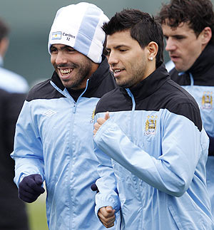 Manchester City's Carlos Tevez (left) with Sergio Aguero (centre) during a training session