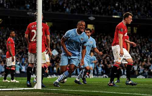 Mamchester City's Vincent Kompany celebrates after scoring during the Premier League match at the Etihad Stadium