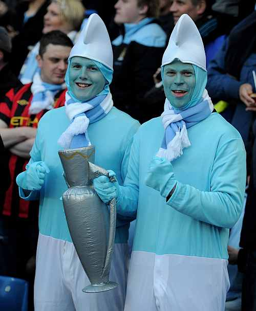 Manchester City fans show their support during the Premier League match at the Etihad Stadium