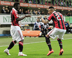 AC Milan's Sulley Muntari (left) and teammate Kevin-Prince Boateng break into a jig after the former scored against Atalanta during their Serie A match on Wednesday