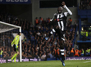 Newcastle United's Papiss Cisse celebrates after scoring against Chelsea during their Premiership match at Stamford Bridge on Wednesday
