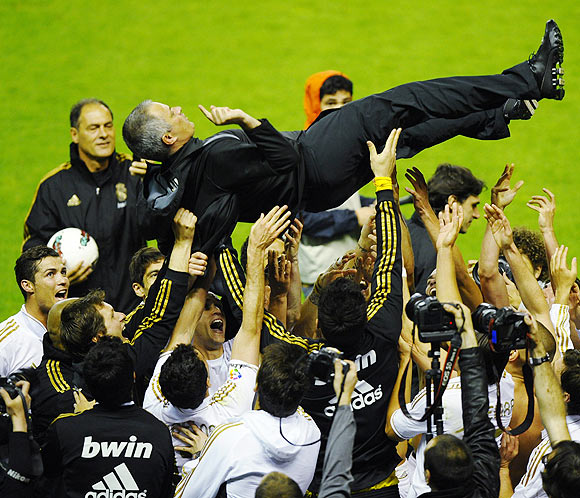 Real Madrid's coach Jose Mourinho is thrown into the air by his players after their win over Athletic Bilbao to clinch the La Liga title on Wednesday