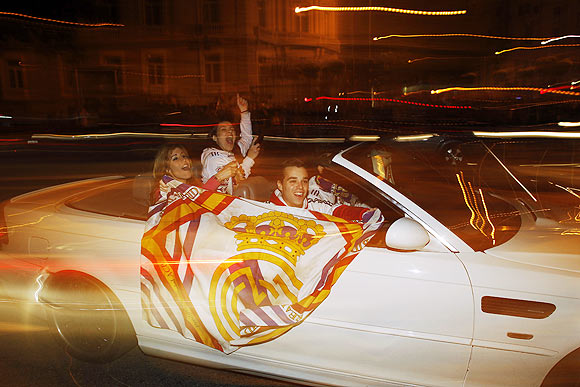 Real Madrid supporters celebrate at Madrid's landmark Cibeles fountain after the team won the La Liga title on Wednesday