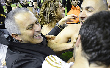Jose Mourinho celebrates with teammates after Real Madrid won the La Liga title on Wednesday