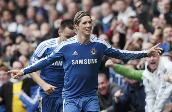 Chelsea's Fernando Torres celebrates his 3rd goal against Queens Park Rangers during their English Premier League soccer match at Stamford Bridge in London