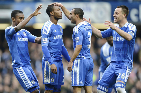 Chelsea's Daniel Sturridge (2nd L) celebrates with teammates after scoring a goal against Queens Park Rangers during their English Premier League soccer match at Stamford Bridge in London