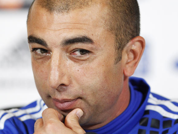 Chelsea's caretaker manager Roberto Di Matteo listens to a question during a news conference at the team's training facility in Stoke D'Abernon, south of London