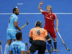 Britain's Ashley Jackson (right) celebrates his first goal against India during the men's International Invitational Hockey Tournament at the Riverbank Arena on the Olympic Park in London on Thursday