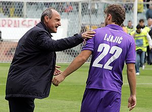 Fiorentina head coach Delio Rossi shouts instructions to his player Adem Ljajic