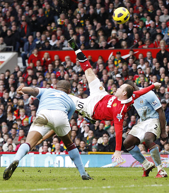 Manchester United's Wayne Rooney scores against Manchester City from an overhead kick during their EPL match at Old Trafford on February 12, 2011