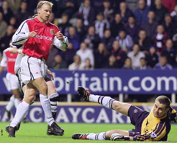 Newcastle United's Shay Given (right) tries to stop Arsenal's Dennis Bergkamp (left) from scoring during their English Premier League match at St James's Park, on March 2, 2002