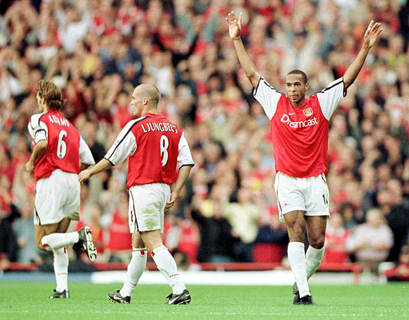Arsenal's Thierry Henry (right) celebrates after scoring against Manchester United on October 1 2000