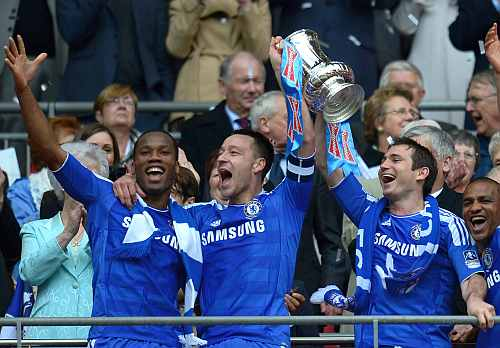 Didier Drogba, John Terry, Frank Lampard of Chelsea lift the FA Cup trophy after beating Liverpool at Wembley