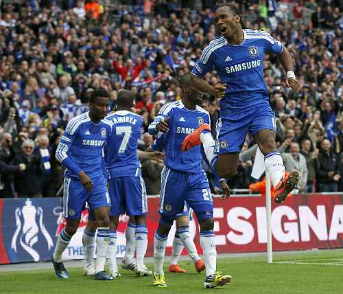Chelsea's Didier Drogba celebrates scoring his team's second goal against Liverpool's during their FA Cup final