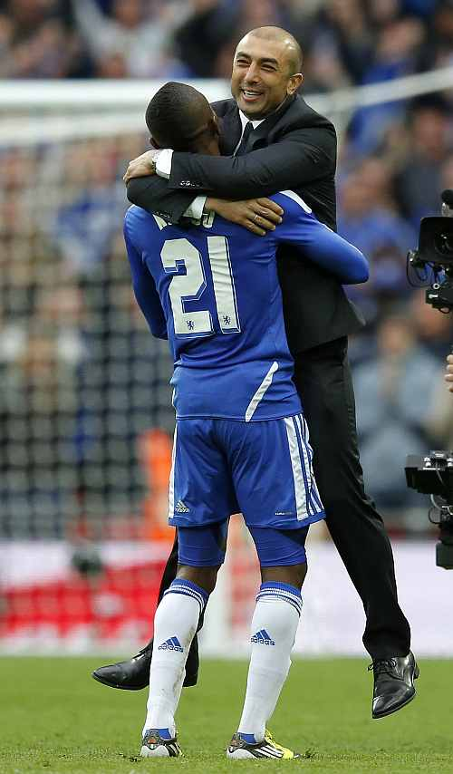 Chelsea's coach Di Matteo celebrates with Kalou after their FA Cup final soccer match against Liverpool at Wembley Stadium in London