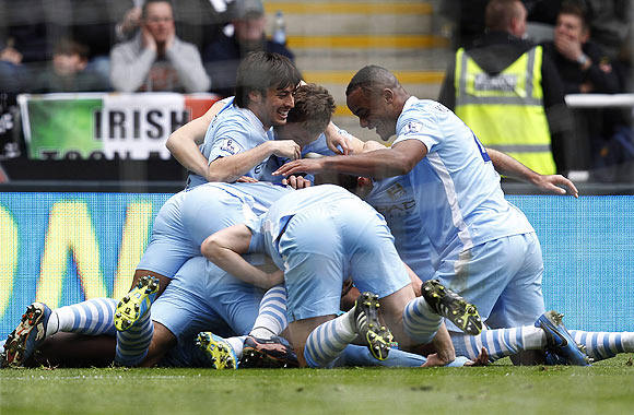 Manchester City players celebrate with Yaya Toure after he scoring against Newcastle United during their EPL match in Newcastle on Sunday