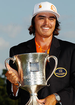 Rickie Fowler of the United States celebrates with the Quail Hollow championship trophy after defeating Rory McIlroy of Northern Ireland and DA Points of the United States in a playoff