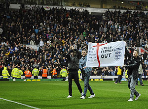 Blackburn Rovers' fans protest on the pitch after their EPL match against Wigan Athletic in Blackburn, on Monday