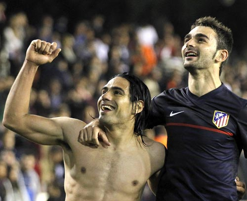 Atletico Madrid strikers Radamel Falcao (left) and Adrian Lopez
